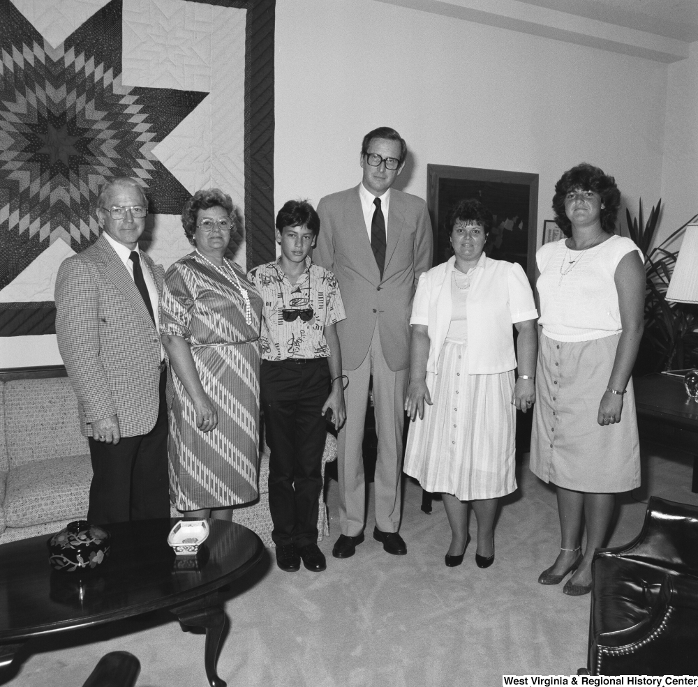 "[""Senator John D. (Jay) Rockefeller poses for a photograph with an unidentified group of visitors from West Virginia in his Washington, D.C. office.""]%"