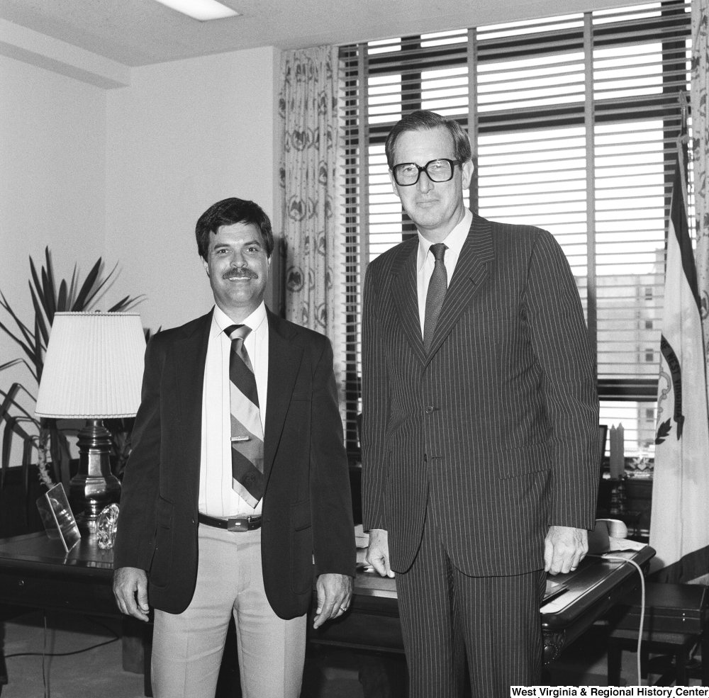 "[""Senator John D. (Jay) Rockefeller stands in his office for a photograph with an unidentified individual.""]%"