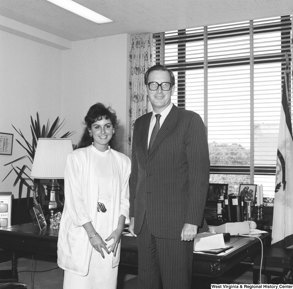 "[""Senator John D. (Jay) Rockefeller stands for a photograph with an unidentified woman in his Dirksen office.""]%"