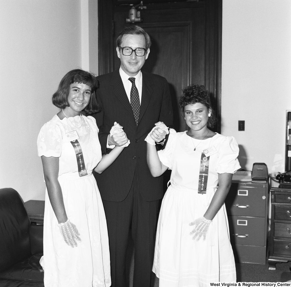 "[""Senator John D. (Jay) Rockefeller holds the hands of the two Girls Nation participants from West Virginia. Girls Nation is a national civic training and learning experience that is facilitated by the American Legion Auxiliary.""]%"