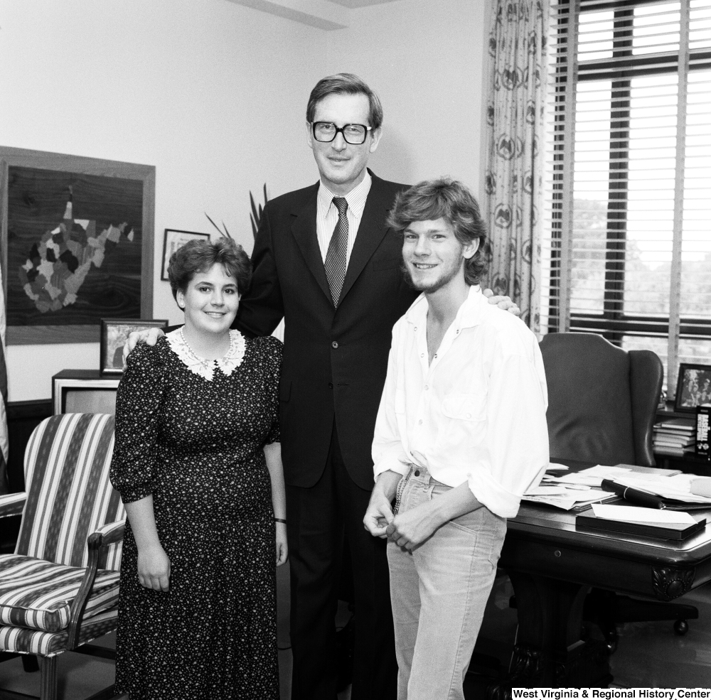 "[""Senator John D. (Jay) Rockefeller stands with two unidentified guests in his Washington office.""]%"