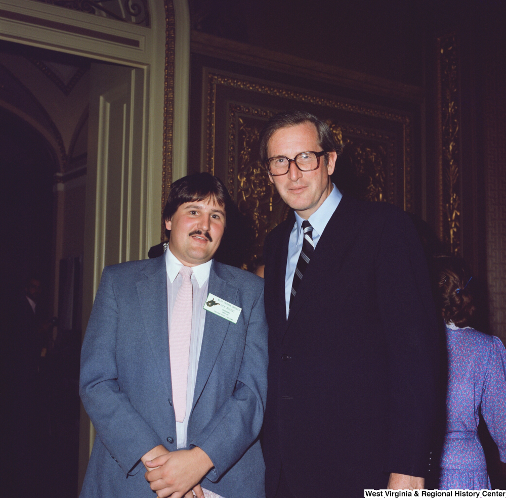 "[""Senator John D. (Jay) Rockefeller stands for a photograph with the 1985-1986 president of West Virginia Jaycees. The United States Junior Chamber (commonly called Jaycees) is a civic organization for young adults that develops leadership skills and emphasizes community service.""]%"
