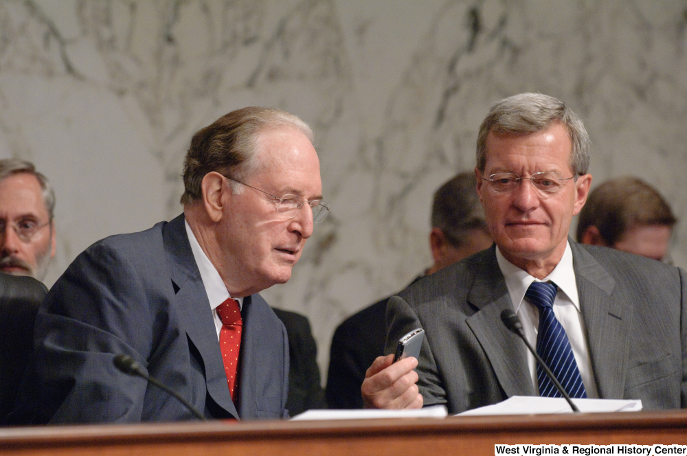 "[""Senator Max Baucus shows his cellphone to Senator John D. (Jay) Rockefeller during an executive meeting on new health care reform legislation.""]%"