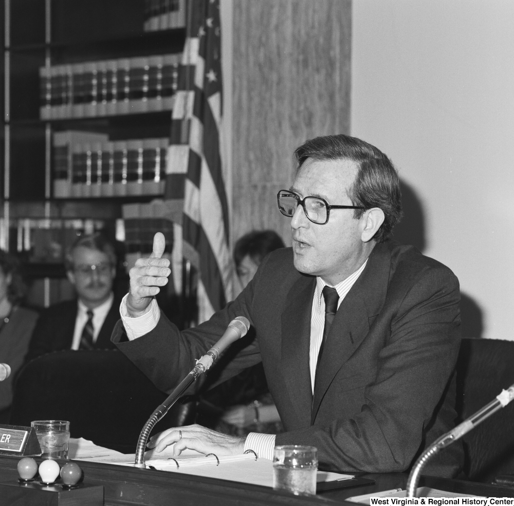 "[""Senator John D. (Jay) Rockefeller gestures with his hand while speaking during a Senate committee hearing.""]%"