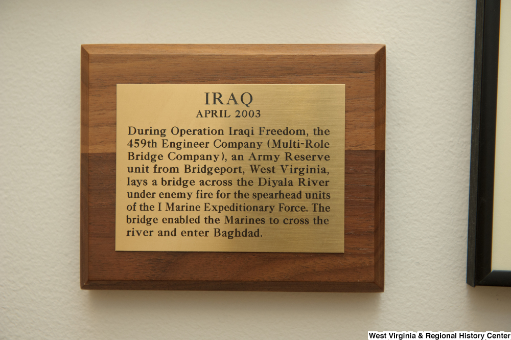 [""\""Iraq: April 2003 During Operation Iraqi Freedom, the 459th Engineer Company (Multi-Role Bridge Company), an Army Reserve unit from Bridgeport, West Virginia, lays a bridge across the Diyala River under enemy fire for the spearhead units of the I Marine Expeditionary Force. The bridge enabled the Marines to cross the river and enter Baghdad.""""]%1000|665|?|e10e8df7f3fe65ba7378b9301e353a2b|False|UNLIKELY|0.32331812381744385