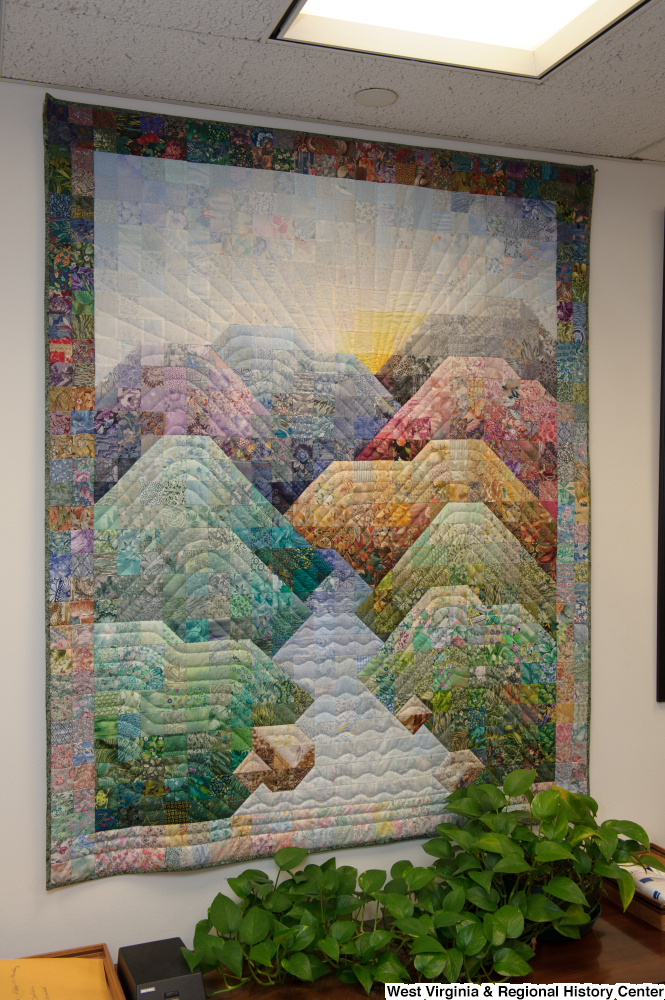 "[""A colorful quilt depicting mountains hangs in Senator John D. (Jay) Rockefeller's office.""]%"