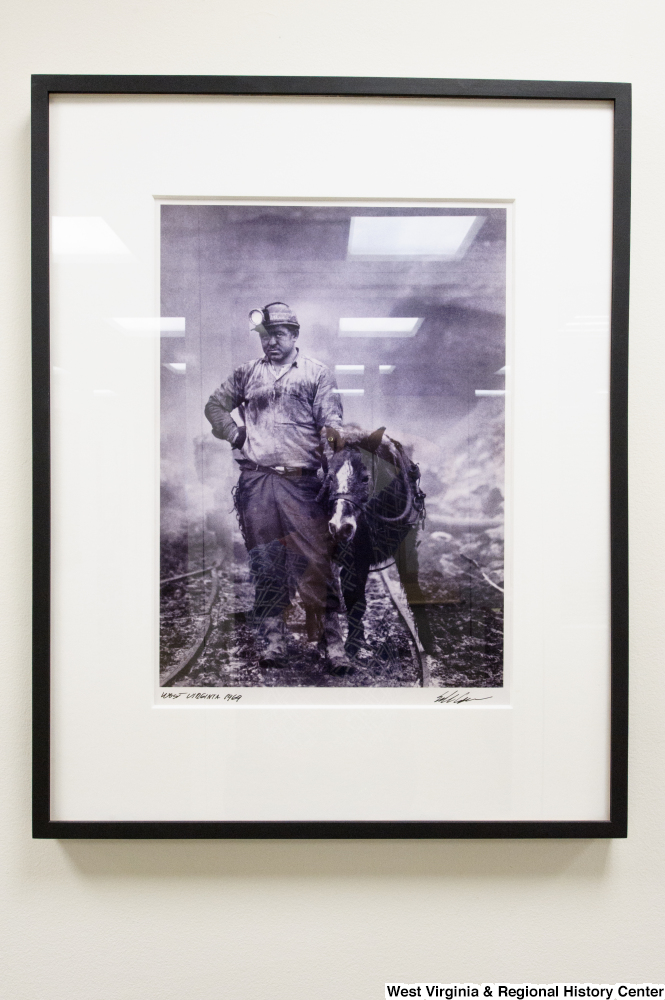 "[""A photograph of a coal miner and a small horse hangs on a wall in Senator John D. (Jay) Rockefeller's office.""]%"