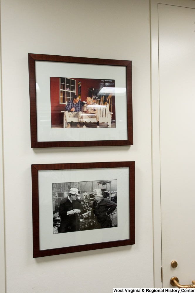 "[""Two photos of Senator John D. (Jay) Rockefeller with West Virginians hang on the wall in his office.""]%"