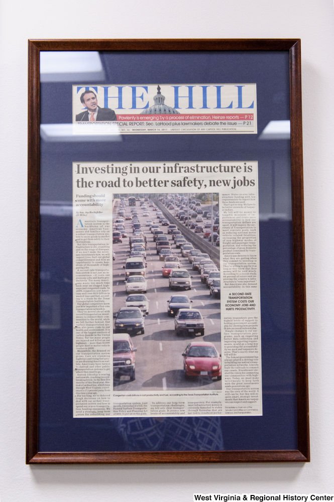 "[""A framed Hill article titled \""Investing in our infrastructure is the road to better safety, new jobs\"" hangs in Senator John D. (Jay) Rockefeller's office.""]%"