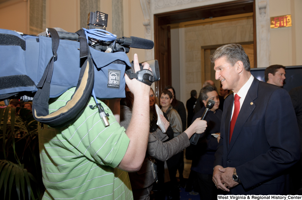 "[""Senator Joe Manchin speaks to press at an event in the Senate.""]%"