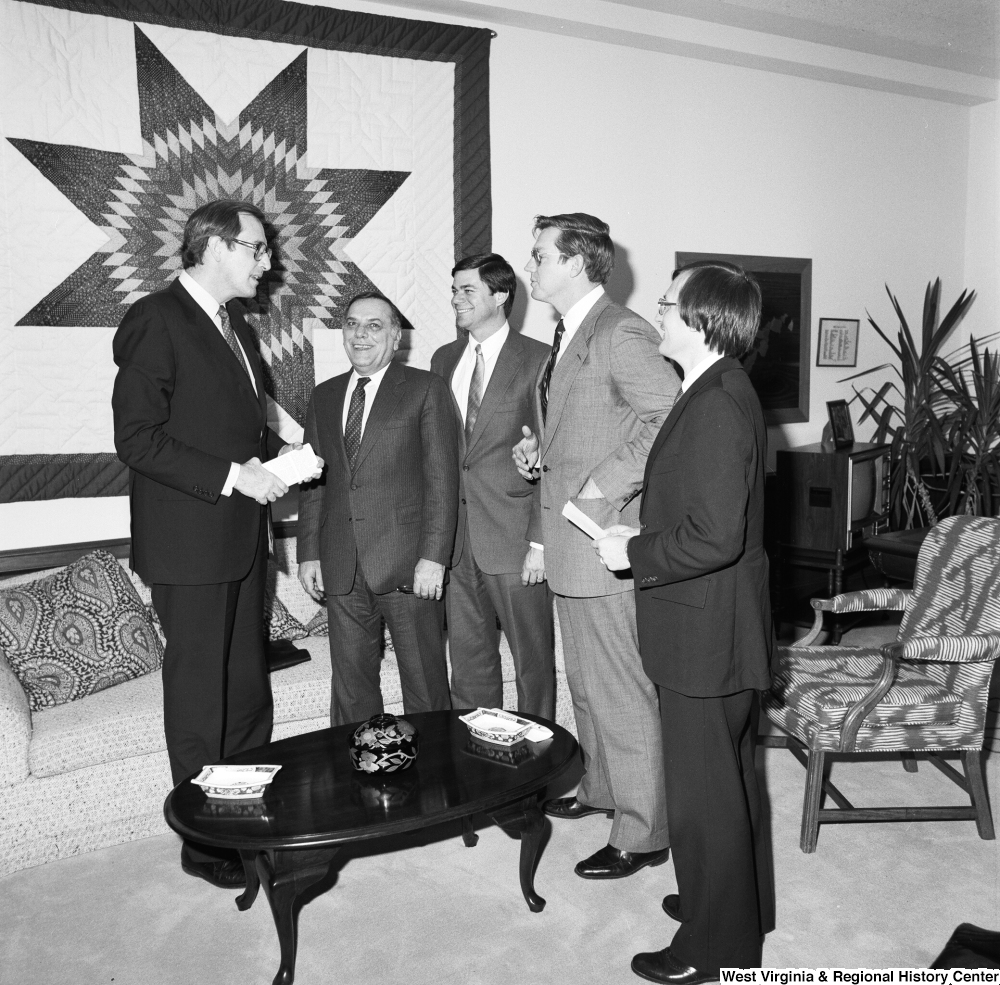 "[""Senator John D. (Jay) Rockefeller meets with an unidentified group in his Washington office.""]%"